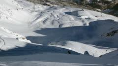 Unmarket ski slope snowboarder Stock Footage