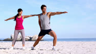 Stock Video Footage of Woman and her coach stretching on the beach
