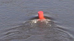 Floating red buoy on river water Stock Footage
