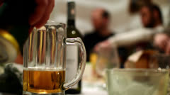 pouring beer at party - stock footage