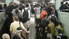 overflow of passengers on stairs - stock footage
