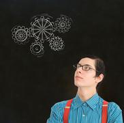 nerd geek businessman student teacher chalk thinking gears cogs - stock photo