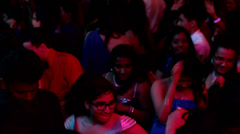 Crowd dancing to the music at a night club Stock Footage