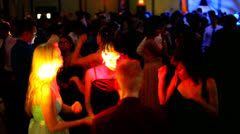 Colorful laser light and young women dancing at a party Stock Footage