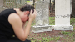 Grieving woman at graves Stock Footage