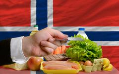 buying groceries with credit card in norway - stock photo