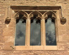 SKY clouds reflected in gothic window Stock Footage