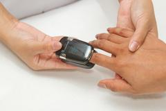 patient with pulse oximeter on finger for monitoring - stock photo