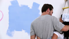 Young couple looking at painted wall Stock Footage