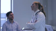 Male patient consulted by a female doctor Stock Footage