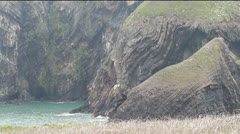 Folded rock strata at Ceibwr Bay, Pembrokeshire, Wales Stock Footage