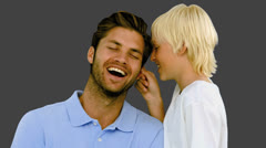 Son pinching the ear of his father on grey background Stock Footage