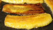 Stock Video Footage of Frying plantain bananas