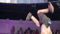 Break dancer spinning dancing head on floor, young male performance - stock footage