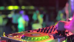 Hands of disc jockey playing set in disko house during music party Stock Footage