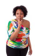 young fatty black woman making silence gesture - african people - stock photo