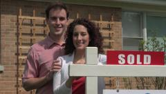 Real Estate, couple standing in front of sold sign - stock footage
