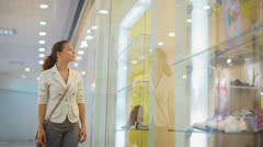 Young, pretty business woman chooses clothes in shop Stock Footage