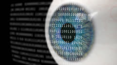 Eye Looking at Binary Code. Stock Footage