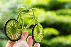 Hand Holding Eco bicycle icon Stock Photos