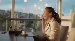 Beautiful girl, woman talking on the phone and laughing and very happy Stock Footage