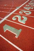 Stadium running track lane markers sports field number markings Stock Photos