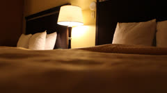 Static shot of two hotel beds Stock Footage