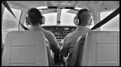 Pilot in Airplane Cockpit - Vintage Film of Plane Interior while Flying Stock Footage