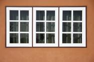 Three white panel front of house Stock Photos