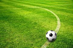 A ball on football field Stock Photos