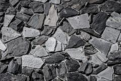 neutral rock pattern wall as backdrop - stock photo