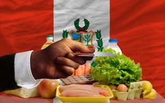 buying groceries with credit card in peru - stock photo