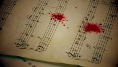 Blood drops on the music papers 1 Stock Footage