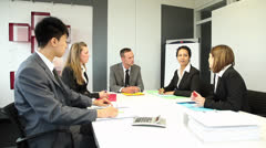 Five international people having a business meeting in a conference room Stock Footage