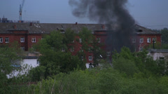 Black smoke in a residential area. fire in omsk. russia. Stock Footage