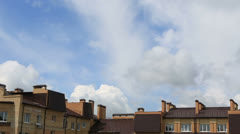 Cumulus clouds float above the apartment building. timelapse view Stock Footage