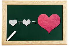 Love or romantic relationship concept presented       on blackboard Stock Photos