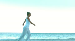 Woman dancing on the beach Stock Footage