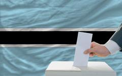 man voting on elections in botswana - stock photo
