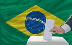 man voting on elections in brazil - stock photo