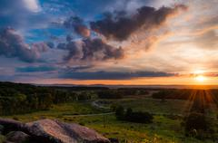 Stock Photo of colorful summer sunset from little roundtop in gettysburg, pennsylvania