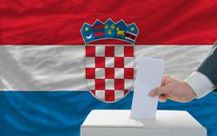 man voting on elections in croatia - stock photo