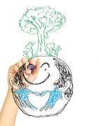 hand drawing tree on earth . - stock photo