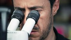 Chemist using microscope Stock Footage