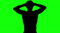 Silhouette of a man tensing arms on green screen Stock Footage