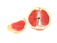 Fruit composition of grapefruit in the form of hours Stock Illustration