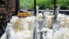 Rapid flowing water on old dam Stock Footage