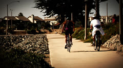 Bikers riding down summer outdoors peolpe lifestyle cutaway transition sunny day Stock Footage
