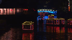 Boats on Xuanwu river by night, Nanjing, China Stock Footage