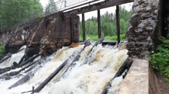 The old destroyed dam on the river, the flow of water through the openings Stock Footage